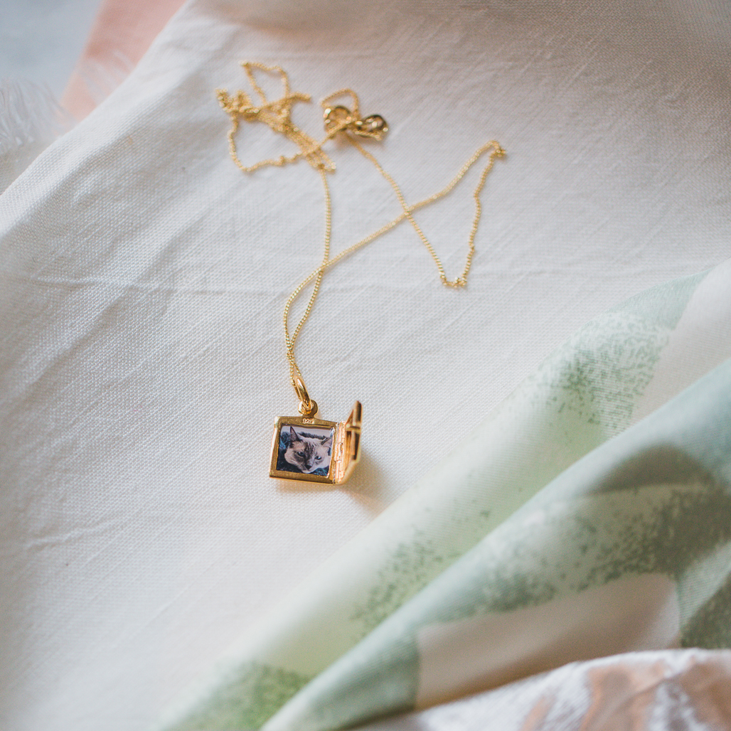 Square Gold Locket with Photo inside of cat who passed away